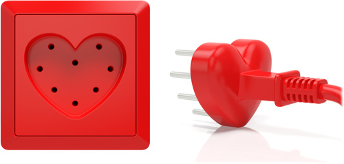 Red, heart-shaped electrical socket with matching plug and cord